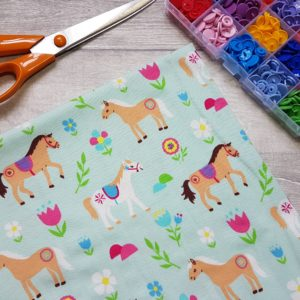 Ponies Mint Cotton Lycra Jersey Knit Fabric