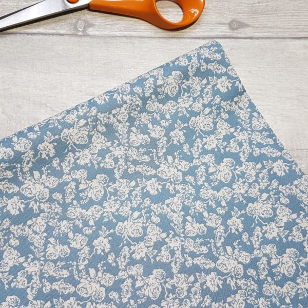 Delicate Rose on Blue Cotton Fabric
